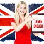 30505611-young-woman-holding-tablet-pc-on-the-background-with-british-national-flag-english-learning-concept.jpg